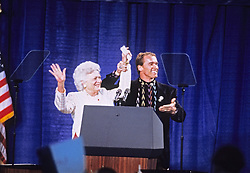Former first lady Barbara Bush, wife of former President George H.W. Bush and mother of former President George W. Bush, died Tuesday at her home in Houston. She was 92. Barbara Bush had been in failing health, suffering from congestive heart failure and chronic obstructive pulmonary disease. George and Barbara, who celebrated their 73rd wedding anniversary on Jan. 6, hold the record for the longest-married presidential pair. Mrs. Bush was known for her wit and emphasis on family. One of her primary causes was literacy. She founded the Barbara Bush Foundation for Family Literacy in 1989 to carry forth her legacy in the cause for literacy.. PICTURED: Feb. 16, 1992 - Derry, New Hampshire, United States of America - Actor ARNOLD SCHWARZENEGGER and first lady BARBARA BUSH speak at a campaign rally for the Bush / Quayle '92 ticket at the Pinkerton Academy in Derry, New Hampshire on February 16, 1992 prior to the 1992 New Hampshire Primary. (Credit Image: © Ron Sachs/CNP/ZUMAPRESS.com)