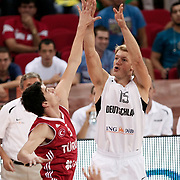 Germany's Jan Henrik Jagla and Turkey's Emir Preldzic (L) during their Adidas Istanbul Cup 2012 basketball final match Germany between Turkey at the Abdi ipekci Arena in Istanbul Turkey on Friday 03 August 2012. Photo by TURKPIX