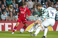 Fotball<br /> UEFA Champions League 2003/2004<br /> 30.09.2003<br /> Celtic v Lyon<br /> Foto: Digitalsport<br /> Norway Only<br /> <br /> JUNINHO (LYON) / ALAN THOMPSON (CEL) <br /> PHOTO LAURENT BAHEUX