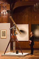 """© Licensed to London News Pictures. 30/01/2014. London, England. Picture: Royal Century refracting telescope on equatorial mount c. 1910W. Watson & Sons, from the<br /> Whipple Museum of the History of Science. The Exhibition """"Discoveries - Art, Science & Exploration"""" from the University of Cambridge Museums opens at Two Temple Place, Embankment, London on 31 January and runs until 27 April 2014. Photo credit: Bettina Strenske/LNP"""