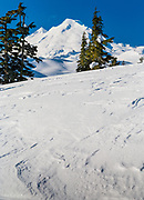 Seen here in winter, Mount Baker, also known as Koma Kulshan or simply Kulshan, is an active glaciated andesitic stratovolcano in the Cascade Volcanic Arc and the North Cascades of Washington State in the United States. It is the second-most active volcano in the range after Mount Saint Helens.