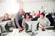 """14/10/2014 14/10/2014 Bredan """"Speedie"""" Smith   teaching coding all over Galway including retired Galway teacher s  Geraldine Kelly Padraigin Moylan and Muriel McDanley and Geraldine Kelly at the Galway Education centre learning coding during the EU CODE WEEK. Photo:Andrew Downes a"""