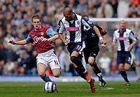 Photo: Glyn Thomas.<br />Aston Villa v West Bromwich Albion. The Barclays Premiership. 09/04/2006.<br /> Villa's Steven Davis (L) and West Brom's Diomansy Kamara.