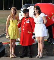 Princess Beatrice; Chelsea Pensioner Paddy Fox; Princess Eugenie Elephant Parade and Auction held at the Royal Hospital Gardens, Chelsea, London, UK, 30 June 2010:  For piQtured Sales contact: Ian@Piqtured.com +44(0)791 626 2580 (Picture by Richard Goldschmidt/Piqtured)