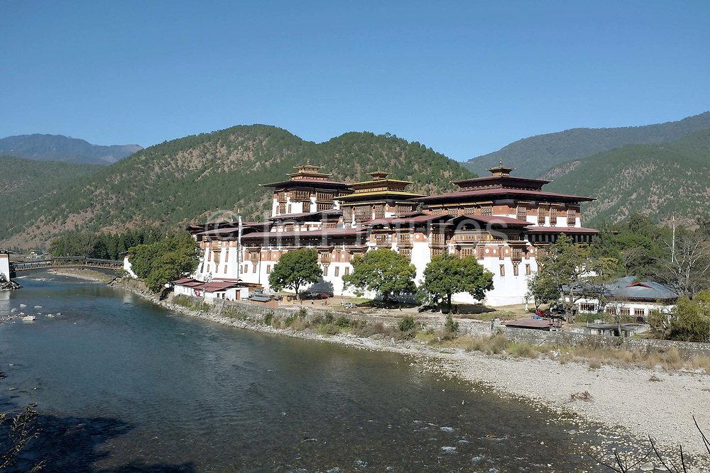 Punakha Dzong (fortress) situated on the junction of the Mo Chhu (Mother river) and the Pho Chhu (Father river) in Punakha, Western Bhutan. Considered the most beautiful and impressive Dzong in Bhutan, Punakha Dzong was the second fortress to be built in Bhutan and it served as the capital and seat of the government until 1955 when Thimphu became the captial of Bhutan.