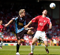 Photo: Leigh Quinnell.<br /> Bristol City v Rotherham United. Coca Cola League 1. 05/05/2007. Bristol Citys David Noble keeps the ball from Rotherhams Martin Woods.