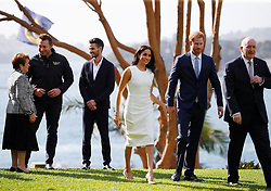 The Duke and Duchess of Sussex, Australia's Governor General Peter Cosgrove (right), his wife Lynne Cosgrove (left) and Olympic swimmer Ian Thorpe (second left) in the grounds of Admiralty House in Sydney, on the first day of the royal couple's visit to Australia.