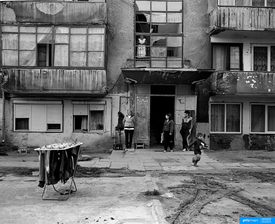 A scene from a housing estate in the heart of the small Romanian town Copsa Mica, Transylvania, Romania. Copsa Mica was once described as the most polluted town in Europe. May 9, 2008. Photo Tim Clayton...Copsa Mica, a small industrial town deep in Transylvania, Romania, was described during the 1990s as the most polluted town in Europe with lead levels reaching were more than 1000 times the allowable International limits and life expectancy nine years shorter than the National average...The pollution was caused entirely by two factories, Carbosin produced black for dies and tires and closed in 1993 while Sometra, a nonferrous smelter is still operational today...The pollution was so bad sheep were black, covered in soot and health officials advised against eating livestock or vegetables and drinking the water or milk...The Communist rule of Nicolae Ceausescu is blamed for the widespread environmental degradation that left industrial parts of Romania in ecological disaster. Industry was situated in a way to concentrate pollution in small areas leaving the rest of the country relatively free of pollution.Copsa Mica in particular was left an environmental disaster...The pollution caused a direct affect on human health with widespread Lung disease, Impotency, the highest infant mortality rate in Europe, Lead poisoning andbehavioral problems...Fifteen years on since the closure of Carbosin in 1993, the factory skeleton remains as part of the towns bleak landscape, Unfinished communist style housing blocks still stand in the heart of the towns housing estate. The town's inhabitants arestill trying to recover from the long lasting effects of pollution...Recent survey's found the soil contained so much lead that it was 92 times above the permitted level; the vegetation had a lead content 22 times above the permitted level. While toxins have penetrated at least one meter (three feet) into the soil leaving the entire food chain in the area contamina