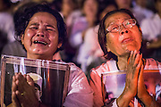 """04 FEBRUARY 2013 - PHNOM PENH, CAMBODIA: Cambodians cry out at the cremation of their former King Norodom Sihanouk during the King-Father's cremation service in Phnom Penh. Norodom Sihanouk (31 October 1922- 15 October 2012) was the King of Cambodia from 1941 to 1955 and again from 1993 to 2004. He was the effective ruler of Cambodia from 1953 to 1970. After his second abdication in 2004, he was given the honorific of """"The King-Father of Cambodia."""" Sihanouk died in Beijing, China, where he was receiving medical care, on Oct. 15, 2012.    PHOTO BY JACK KURTZ"""
