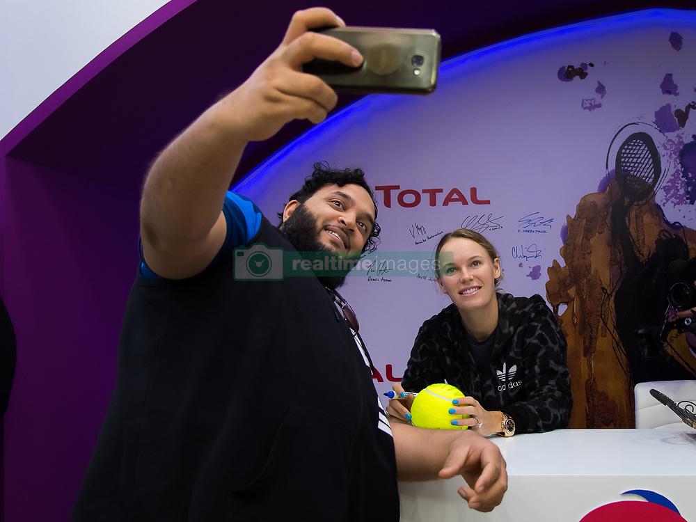 February 12, 2019 - Doha, QATAR - Caroline Wozniacki of Denmark visits the Total Booth at the 2019 Qatar Total Open WTA Premier tennis tournament (Credit Image: © AFP7 via ZUMA Wire)