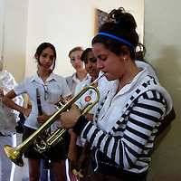 Central America, Cuba, Santa Clara. Girl playing trumpet at the Santa Clara Musical School of Art.