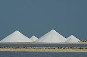 Salt mounds and Evaporation Ponds.<br /> Sea Salt Production Plant started in the 1600's and worked by African Slaves.<br /> Cargill Solar Salt Works<br /> Pekelmeer lagoon<br /> BONAIRE, Netherlands Antilles, Caribbean
