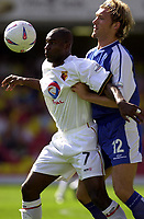 Photo. Richard Page<br />Watford v Millwall. Nationwide Division One. 13/09/2003.<br />Bruce Dyer is challenged by Darren Ward.