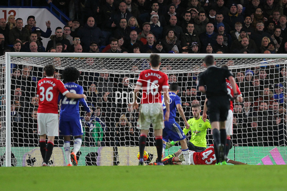 David De Gea of Manchester United is beaten by Chelsea's Diego Costa during the Barclays Premier League match between Chelsea and Manchester United at Stamford Bridge, London, England on 7 February 2016. Photo by Phil Duncan.