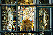 See the beacon's bulb through a rotating Fresnel lens at Heceta Head Lighthouse State Scenic Viewpoint, on the Oregon coast, USA. While seeking to extend Spanish hegemony in the late 1700s, Spanish explorer Bruno de Heceta mapped the mouth of the Columbia River and much more along the Pacific Northwest coast; and in 1862, the US Coast Survey named Heceta Head in his honor. Built atop a 56-foot tower in 1893, this Lightstation's coastal safety beacon was first illuminated in 1894. Perched 205 feet above the ocean, its fresnel lens focuses the brightest light on the Oregon coast, visible up to 21 miles out to sea. Heceta Head is found halfway between Yachats and Florence (2.1 miles south of Carl Washburne State Park). From the large parking lot, walk 1 mile round trip to the Lighthouse.