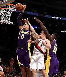 December 23, 2017 - Los Angeles, California, U.S. - Los Angeles Lakers forward Kyle Kuzma (0) takes the final shot of the game and misses past Portland Trail Blazers guard Pat Connaughton (5) in the second half of a NBA Basketball game at Staples Center on Saturday, Dec. 23, 2017 in Los Angeles. (Credit Image: © Keith Birmingham/SCNG via ZUMA Wire)