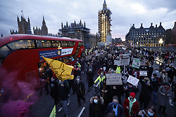 © Licensed to London News Pictures. 15/03/2021. London, UK. Protesters gather on Westminster Bridge as anger continues over the policing of Saturday's Sarah Everard vigil at Clapham Common in south London. Photo credit: Peter Macdiarmid/LNP