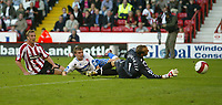 Photo: Aidan Ellis.<br /> Sheffield United v Middlesbrough. The Barclays Premiership. 30/09/2006.<br /> Sheffield's Rob Hulse slides the ball past boro Keeper Mark Schwazer to score the first goal