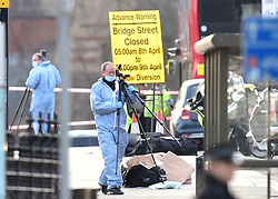Police forensic officers on Westminster Bridge, close to the Palace of Westminster, London, after policeman has been stabbed and his apparent attacker shot by officers in a major security incident at the Houses of Parliament.