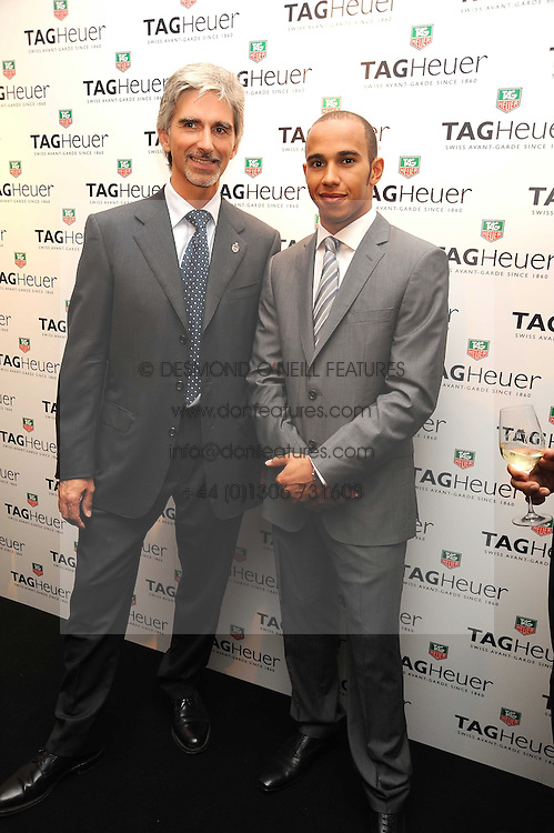 Left to right, DAMON HILL and LEWIS HAMILTON at the TAG Heuer British Formula 1 Party at the Mall Galleries, London on 15th September 2008.