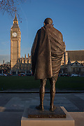 The monument to Indian leader Mahatma Gandhi with the British Houses of Parliament in the background, on 18th January 2017, in Parliament Square, London England. Mohandas Karamchand Gandhi was the preeminent leader of the Indian independence movement in British-ruled India.