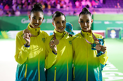 Bronze medallists in Rhythmic Gymnatics Individual All-Around Team (left to right) Australia's Enid Sung, Danielle Prince and Alexandra Kiroi-Bogatyreva at the Coomera Indoor Sports Centre during day seven of the 2018 Commonwealth Games in the Gold Coast, Australia.