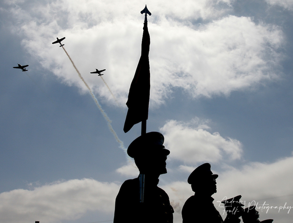 /Andrew Foulk/ For the Californian/.Members of the Semper Fi Memorial Honor Detail, stand at attention as the T-34 Heritage Foundation performs the missing man flight over the Lake Elsinore cemetery, during the Memorial Day ceremony.