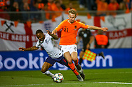 England forward Raheem Sterling (Manchester City) is bright down by Netherlands Midfielder Frenkie de Jong (Ajax) no penalty during the UEFA Nations League semi-final match between Netherlands and England at Estadio D. Afonso Henriques, Guimaraes, Portugal on 6 June 2019.
