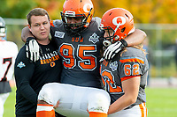 KELOWNA, BC - OCTOBER 6: Karn Sidhu #95 is assisted off the field by a coach and JJ Heaton #62 of Okanagan Sun against the VI Raiders at the Apple Bowl on October 6, 2019 in Kelowna, Canada. (Photo by Marissa Baecker/Shoot the Breeze)