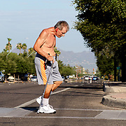 """""""I believe in the power of the human spirit to overcome anything"""", says Frank Zak, 60, who walks twice a day, every day, around his midtown neighborhood in Tucson, Arizona.  Zak sustained major injuries in 1982 when his motorcycle was struck by a drunk driver and he was paralyzed and was injured again in another accident with a truck in 2003 where his neck was broken.  """"It is amazing how many people are supportive.  There is still a lot of good people out there--I am really encouraged by that"""", he added about people he encounters along the way."""