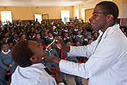 Children from Matsie Steyn primary school, Sharpeville, Vereeniging, South Africa, enjoy the show 'About Us – Stepping Up', an AREPP: Theatre for Life production providing interactive social life skills education to school children through theatre productions. They are based in Johannesburg, South Africa and are on tour for 3 months doing performances everyday at schools across the country.