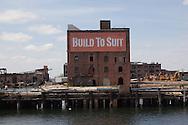 New York. brooklyn. Red Hook . the old docks area under renovation. are suposed to become a trendy area, old destroyed factories  New York, - United states  / le quartier de Red Hook . Brooklyn , les anciens docks au bord de la mer se transforment en quartier a la mode. , New York - Etats unis