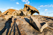 Silhouetted photographer in front of the Remarkable Rocks, Kangaroo Island, Australia