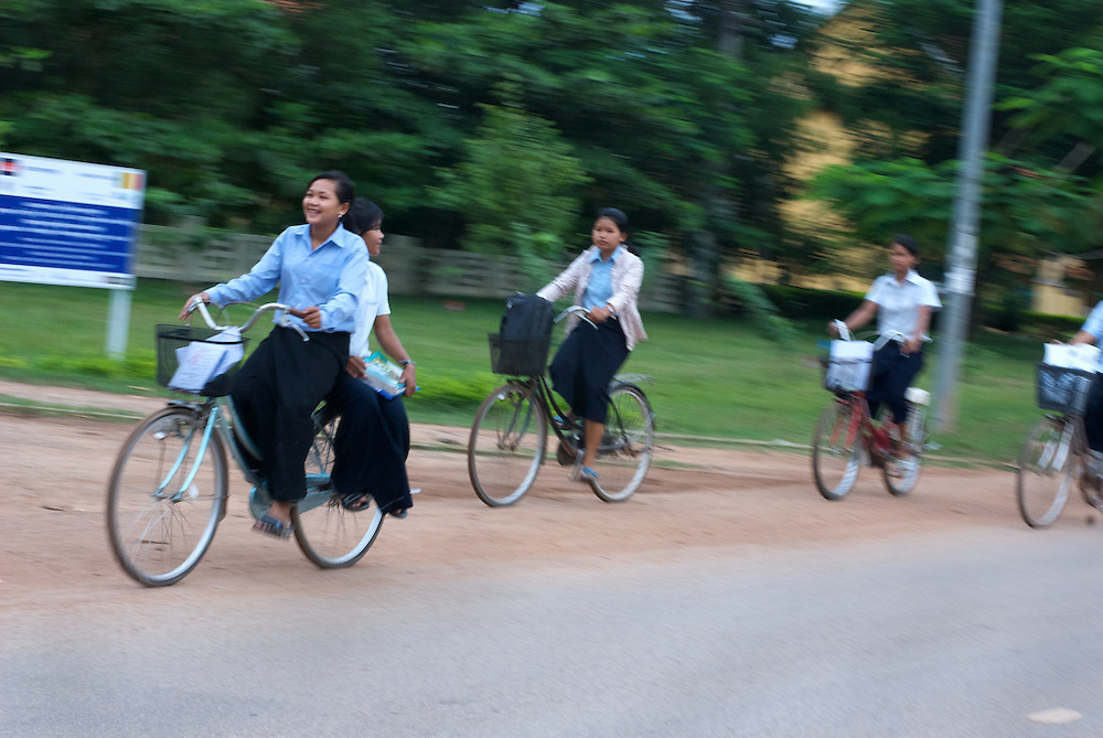 Students bike home after classes at the Provincial Teacher Training College in Siem Reap, Cambodia, which trains young adults to teach locally.  The school is free of charge for all who can pass an admission test.