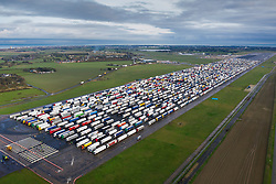 © Licensed to London News Pictures. 22/12/2020. Manston, UK. Hundreds of trucks fill the runway at the former RAF airfield at Manston in Kent as the Port of Dover remains closed.  France is among a number of countries to ban travel from the UK as Covid-19 infections rise dramatically and the possibility of a new mutant strain. Photo credit: Peter Macdiarmid/LNP