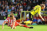 Burton Albion midfielder David Templeton (11) is fouled during the EFL Sky Bet League 1 match between Burton Albion and Sunderland at the Pirelli Stadium, Burton upon Trent, England on 15 September 2018.