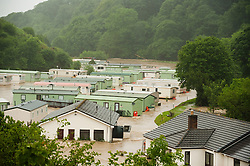 @ London News Pictures.  June 9 2012. Talybont, UK. Caravans and cars  submerged by the waters of the River Leri at the Riverside Caravan park, near Talybont Ceredigion, UK. Earlier three residents hgad to be evacuated by RAF Sea King helicopter as the waters flooded their caravans. Photo credit: Keith Morris/LNP