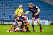 Pierre Schoeman (#1) of Edinburgh Rugby is collared by Romain Briatte (#6) of SU Agen Rugby, as Ben Toolis (#4) of Edinburgh Rugby watches on during the European Rugby Challenge Cup match between Edinburgh Rugby and SU Agen at BT Murrayfield, Edinburgh, Scotland on 18 January 2020.