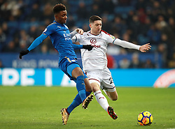 """Burnley's Stephen Ward (right) and Leicester City's Demarai Gray battle for the ball during the Premier League match at the King Power Stadium, Leicester. PRESS ASSOCIATION Photo Picture date: Saturday December 2, 2017. See PA story SOCCER Leicester. Photo credit should read: Mike Egerton/PA Wire. RESTRICTIONS: EDITORIAL USE ONLY No use with unauthorised audio, video, data, fixture lists, club/league logos or """"live"""" services. Online in-match use limited to 75 images, no video emulation. No use in betting, games or single club/league/player publications."""