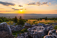 The sun sets over Canaan Valley as viewed from the rocky outcrops high atop the Dolly Sods Wilderness Area in West Virginia.