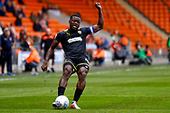 Wimbledon defender Adedeji Oshilaja (4) crosses the ball in  during the EFL Sky Bet League 1 match between Blackpool and AFC Wimbledon at Bloomfield Road, Blackpool, England on 20 October 2018.