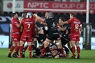 a fight breaks out in the 2nd half between Ospreys and Scarlets players. Guinness Pro14 rugby match, Ospreys v Scarlets at the Liberty Stadium in Swansea, South Wales on Saturday October 7th 2017. <br /> pic by Andrew Orchard, Andrew Orchard sports photography.