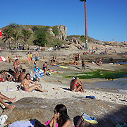 A beach scene at the beachside rock pools at Arpoador beach,  Rio de Janeiro, Brazil. 4th July 2010. Photo Tim Clayton.