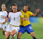 Beijing, CHINA.   Olympic Football, Women's Gold  Medal Game, USA vs BRA,  left, Christie RAMPONE and left BRA's.  MARTA, on the ball at the Beijing Workers Stadium. Thursday,  21.08.2008 [Mandatory Credit: Peter SPURRIER, Intersport Images]