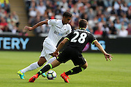 Kyle Naughton of Swansea city goes past Cesar Azpillicueta of Chelsea. Premier league match, Swansea city v Chelsea at the Liberty Stadium in Swansea, South Wales on Sunday 11th Sept 2016.<br /> pic by  Andrew Orchard, Andrew Orchard sports photography.