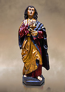 Gothic wooden statue of Sant Joan Evangelista (John the Evangelist) from Gremany, circa 1500, tempera and gold leaf on wood.  National Museum of Catalan Art, Barcelona, Spain, inv no: MNAC  64114. .<br /> <br /> If you prefer you can also buy from our ALAMY PHOTO LIBRARY  Collection visit : https://www.alamy.com/portfolio/paul-williams-funkystock/gothic-art-antiquities.html  Type -     MANAC    - into the LOWER SEARCH WITHIN GALLERY box. Refine search by adding background colour, place, museum etc<br /> <br /> Visit our MEDIEVAL GOTHIC ART PHOTO COLLECTIONS for more   photos  to download or buy as prints https://funkystock.photoshelter.com/gallery-collection/Medieval-Gothic-Art-Antiquities-Historic-Sites-Pictures-Images-of/C0000gZ8POl_DCqE