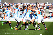 Mark Hudson of Huddersfield Town ( 4 centre) celebrates with his teammates after scoring his teams 2nd goal to make it 2-1. Skybet football league championship match, Huddersfield Town v Derby county at the John Smith's stadium in Huddersfield, Yorkshire on Saturday 18th April 2015.<br /> pic by Chris Stading, Andrew Orchard sports photography.