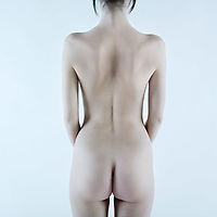 studio shot picture of the back young beautiful naked caucasian woman