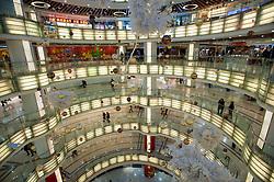 Interior view of spectacular circular atrium inside modern new Joy City shopping mall in Xidan district of Beijing 2009
