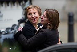 © Licensed to London News Pictures. 21/01/2016. London, UK. MARINA LITVINENKO embraces a friend as she leaves the The High Court in London where a  report into the killing of  her husband, Alexander Litvinenko was released. Alexander Litvinenko was poisoned with the radioactive isotope polonium-210  in London. Photo credit: Ben Cawthra/LNP